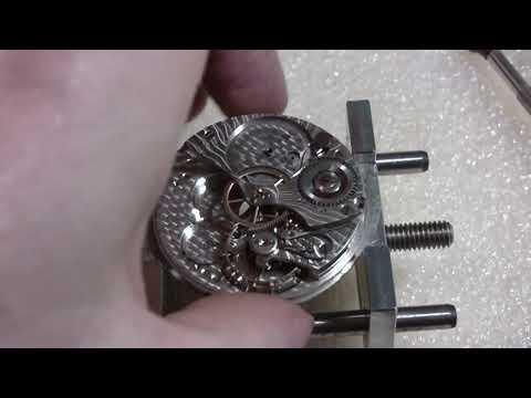 Making pocket watch run better, Bunn, Illinois Watch Co.