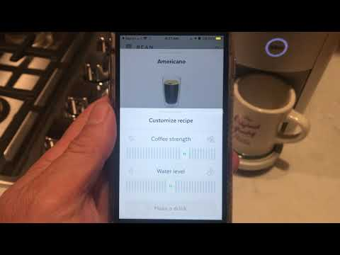 Brewing a cup of coffee with the Spinn Coffee machine.